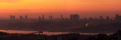 Evening views and orange sky over buildings and streets of Istanbul city. Panorama Silhouettes and outlines of skyscrapers on the background of sunset.