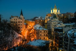 Evening winter view of Andriyivskyy Uzviz Descent with Saint Andrew's Church in the background. Kyiv, Ukraine.