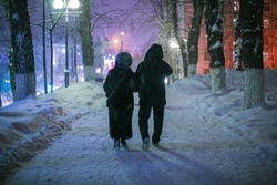 Evening winter walk in the Park of people in love