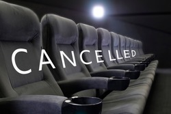 Event cancelled background. Word CANCELLED on empty seats of cinema, theater, conference hall. Festival rejected concept. Event cancelled background. Meeting cancelled. Fish eye effect