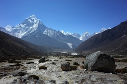 Everest trek, Huge boulder on the way down from Dughla to Pheriche with view of Ama Dablam mountain. Himalayas, Nepal