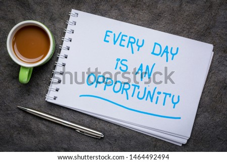 Every day is an opportunity - inspirational handwriting in a spiral art sketchbook against textured bark paper with a cup of coffee
