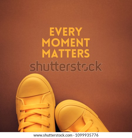 Every moment matters motivational quote, young person in casual canvas shoes standing over the text #1099935776