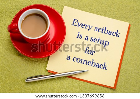 Every setback is a setup for a comeback - handwriting on a square note with a cup of coffee and pen