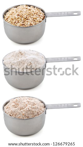 Everyday staple ingredients - rolled oats, plain or all-purpose flour and wholemeal or wheatmeal flour - in cup measures, isolated on a white background