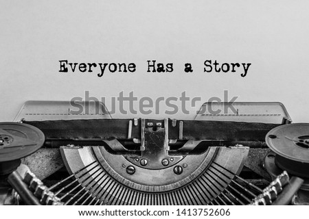 Photo of Everyone has a story printed on a vintage typewriter.