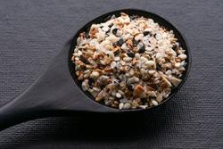 Everything Bagel Seasoning on a Black Spoon