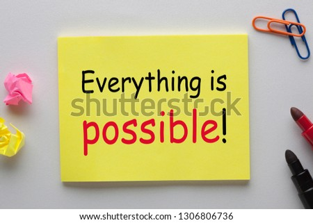 Everything is possible written on note with marker pen and various stationery. Business concept #1306806736
