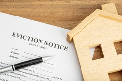 Eviction Notice Document and toy house on table