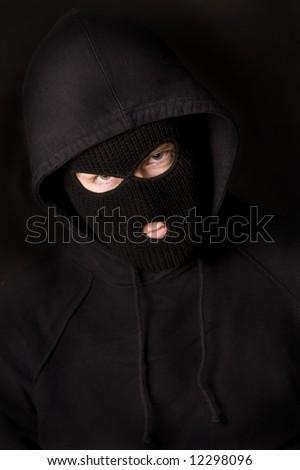 evil criminal wearing balaclava