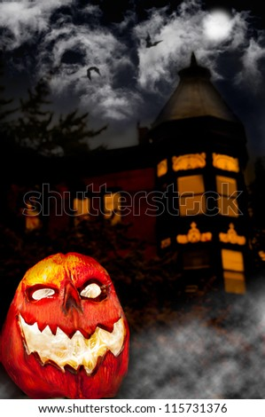 Evil Pumpkin - Jack O Lantern in front of Haunted House