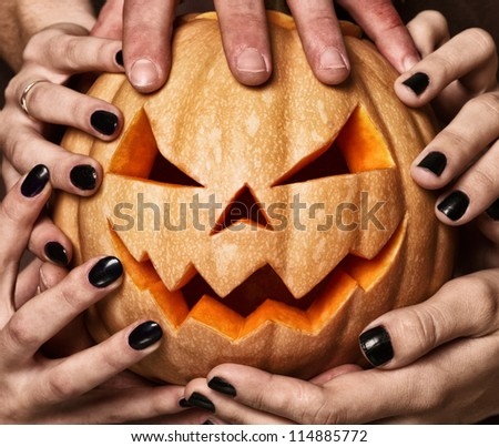 evil pumpkin that are holding, closeup