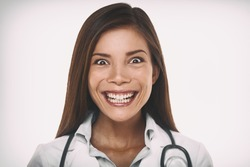 Evil smile mean psychopath doctor concept. Scary crazy Asian professional portrait woman smiling with a malicious laugh looking insane.