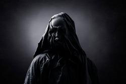 Evil spirit over dark misty background