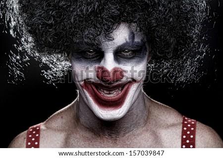 Evil Spooky Clown Portrait on Black Background