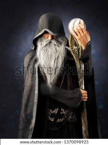 Evil Warlock old hooded wizard posing with staff on a blue gradient background. 3d rendering Сток-фото ©