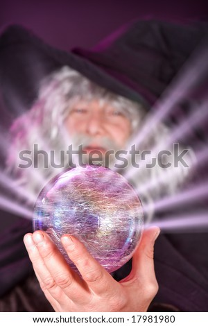 Evil wizard looking into his magic sphere