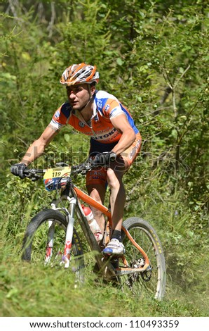EVOLENE, SWITZERLAND  AUGUST 18:  Ramon Sagues Portabella (SPA) 16th placed in the world famous Grand Raid mountain bike race:  August 18, 2012 in Evolene Switzerland