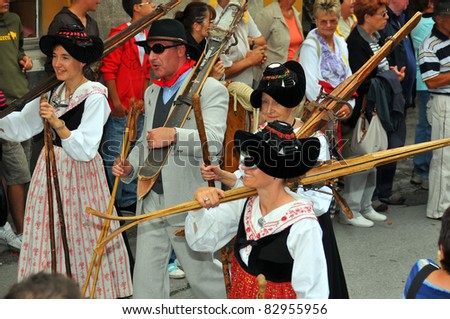 EVOLENE, SWITZERLAND - AUGUST 15: skiers from the past at the International Festival of Folklore and Dance from the mountains (CIME) : August 15, 2011 in Evolene Switzerland