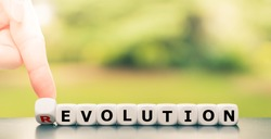 Evolution instead of revolution. Hand turns a dice and changes the word
