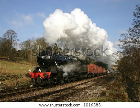 ex London Midland and Scottish Railway locomotive 42968 with a goods train at Haworth, West Yorkshire