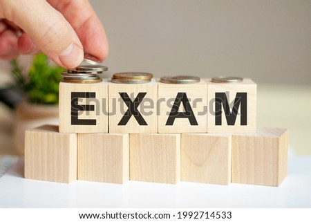 exam letters written on wooden toy blocks, business concept