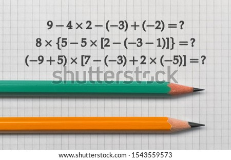 Example of the basic math operations and a pencil on bright background Stock fotó ©
