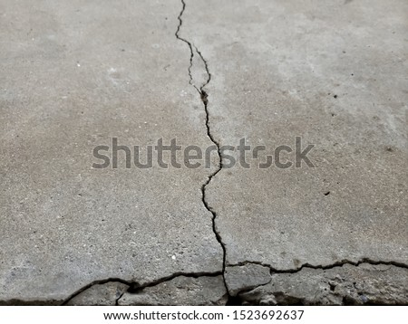 Examples of cracked foundations and sidewalks or driveways in need of foundation or driveway concrete repair #1523692637