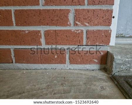 Examples of cracked foundations and sidewalks or driveways in need of foundation or driveway concrete repair #1523692640