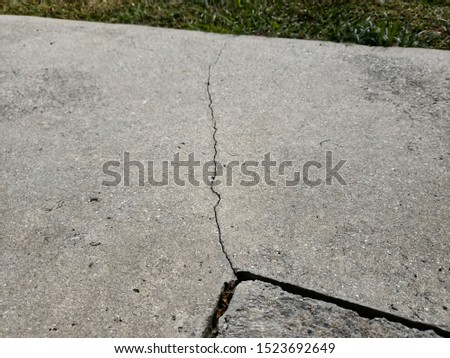 Examples of cracked foundations and sidewalks or driveways in need of foundation or driveway concrete repair #1523692649