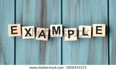 examples word written on wood block. examples text on table, concept. ストックフォト ©