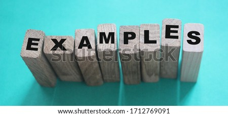 Examples word written on wooden blocks. Education or storytelling marketing concept. ストックフォト ©
