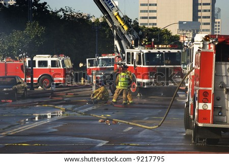 Exausted Fire Men taking control of a building fire