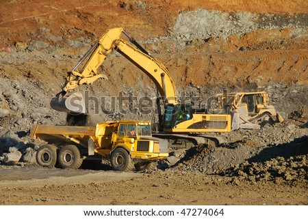 Excavation equipment moving the blasted rock during a large construction project in Roseburg Oregon - stock photo