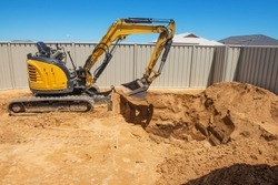 Excavation works for the installation of a swimming pool.Swimming pool under construction.Construction site.
