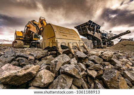 Excavator and machinery in an outdoor mine
