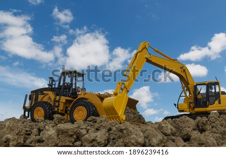 Excavator and Wheel loader are digging the soil in the construction site on the blue sky  background Foto stock ©