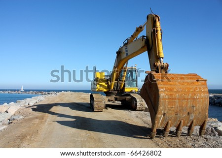 Excavator at a construction site on the coast of Barcelona.