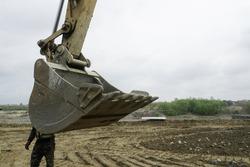 Excavator bucket. Bucket of an excavator on a construction site. detail.