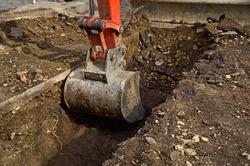 Excavator bucket closeup .Excavation, channel