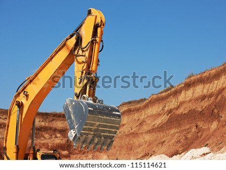 Excavator bucket in limestone mine