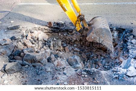 Excavator bucket machinery equipment road, ground. Excavator bucket machinery equipment for road repair industry, ground
