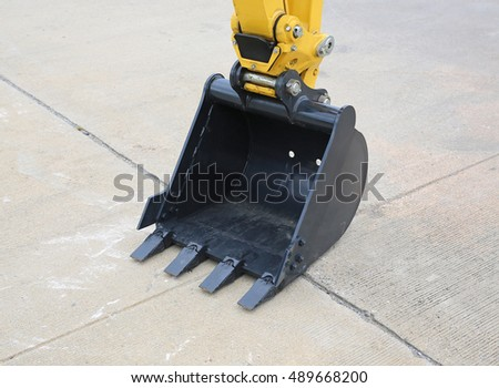 Excavator bucket on cement ground, Industrial excavator machine