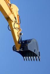 excavator bucket opposite blue sky