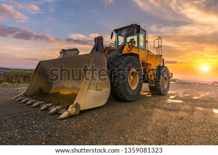Photo of  Excavator building a road in a site construction