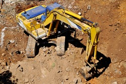 Excavator continues to work at the construction site, excavation site and excavator