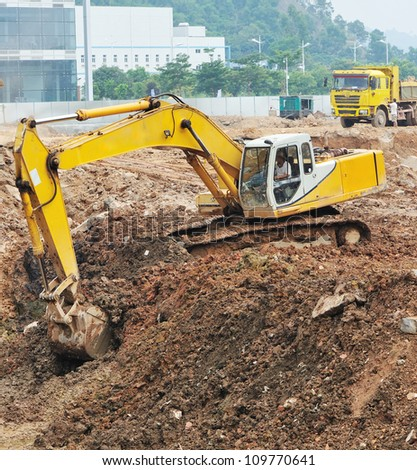 excavator digging at construction site