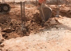 Excavator digging in construction site