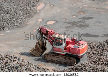 Excavator in a stone pit - stock photo