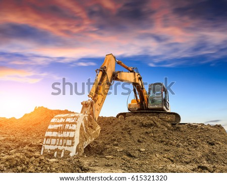 excavator in construction site on sunset sky background #615321320